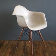 Eames Herman Miller molded fibreglass armchair with wood dowel base in light greige