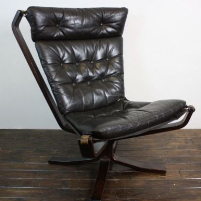 Vintage dark brown leather rosewood framed Falcon chair designed by Sigurd Ressell