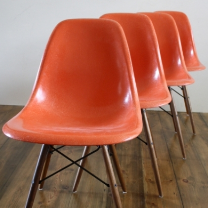 eames herman miller dsw side chairs in orange lovely and company. Black Bedroom Furniture Sets. Home Design Ideas
